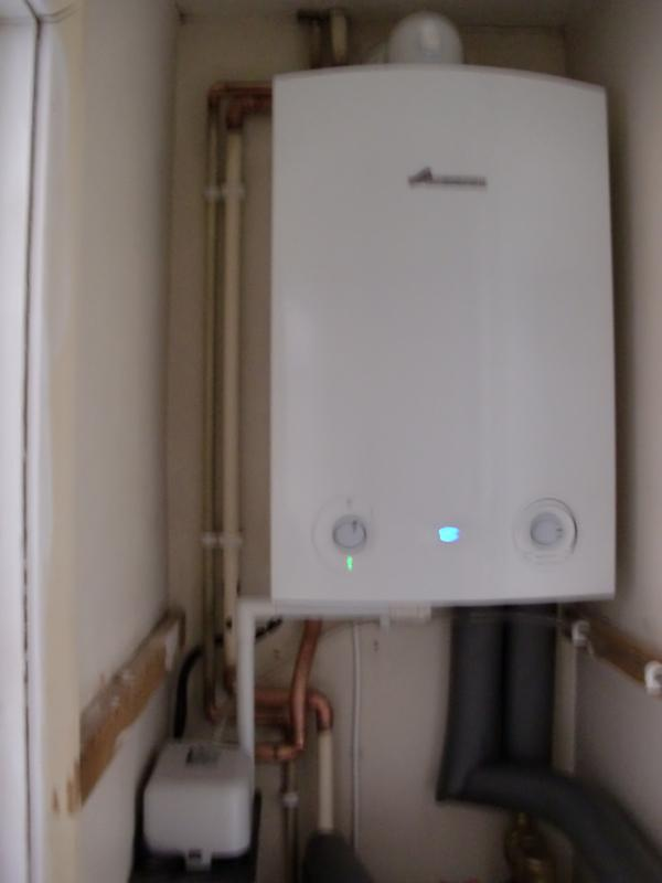 Image 18 - Boiler installed in the airing cupboard with a condensation pump