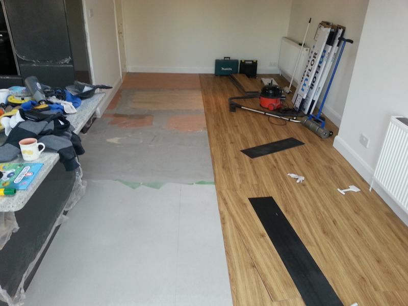 Image 9 - Taking shape. Flooring going down.
