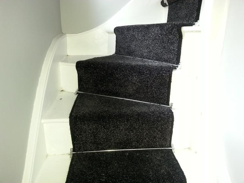 Image 5 - Very effective. Black carpet black edges with silver rods