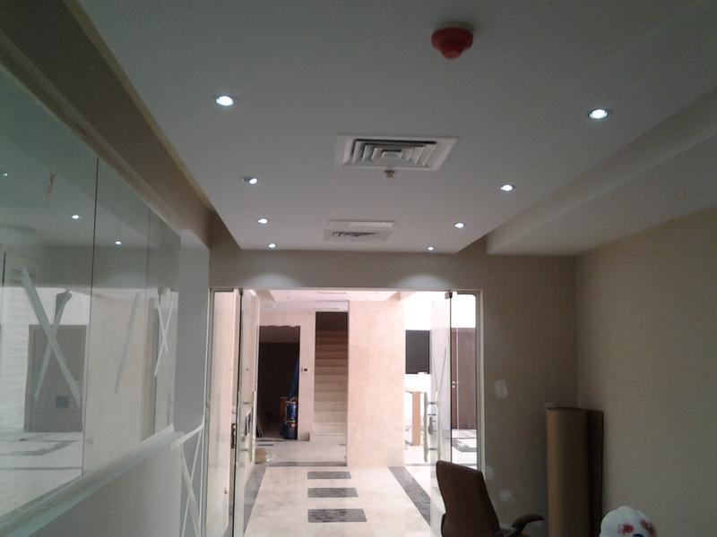 Image 87 - New lighting, replastering and tiling to lobby area