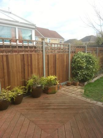 Image 3 - Closeboard panels and trellis with concrete gravel boards and posts.