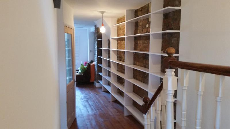 Image 67 - Large bespoke book shelving.