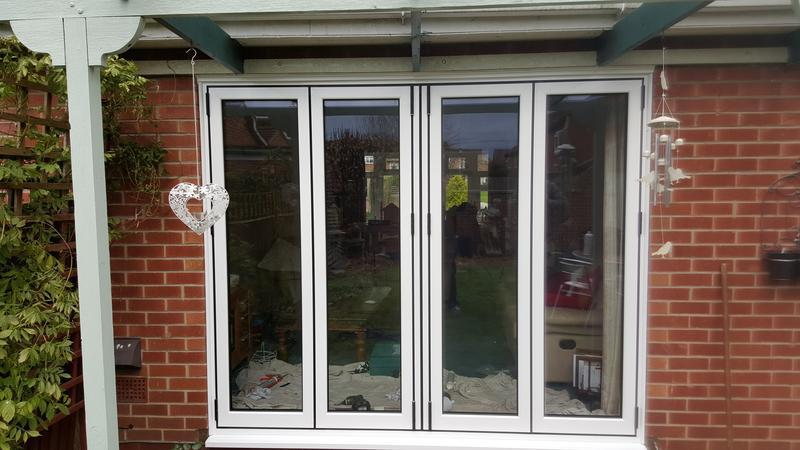 Image 20 - white aluminium bi-fold door installed in bottesford