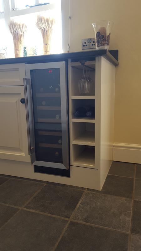 Image 14 - Nicely installed wine fridge, we supplied an extra socket for this with a little re jigging and provided a high quality bespoke wine bottle holder complete with wine glass rack on the top shelf, this replaced a standard 600 cupboard. We work with a few quality local tradesmen to provide whatever you need at the correct price.