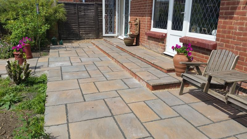 Image 4 - We replaced the old wooden decking with a beautiful slabbed area.