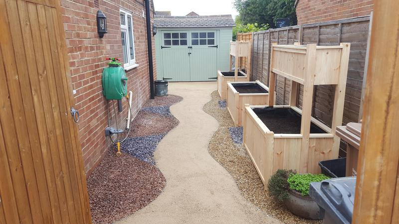 Image 48 - new breeden path with diffrent colour stones and bespoke hand made flower/vegetable boxes.