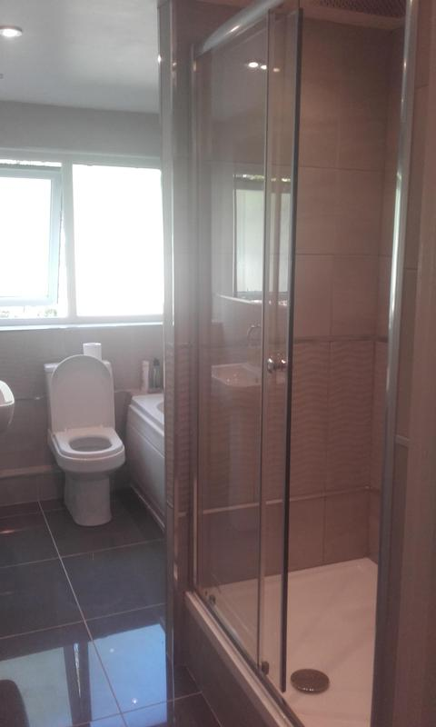 Image 7 - Modern bathroom with cupboard converted to new shower