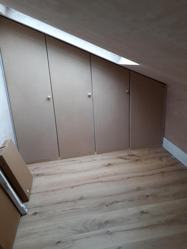 Image 12 - Custom built wardrobe in alcove of loft conversion. Pre-decoration.