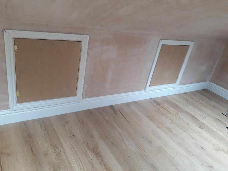 Image 13 - View of installed loft storage hatches in newly built loft conversion. Pre-decoration.