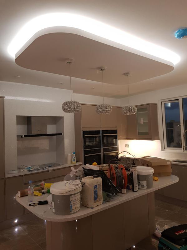 Image 12 - Led lighting above a kitchen island with drop down pendants