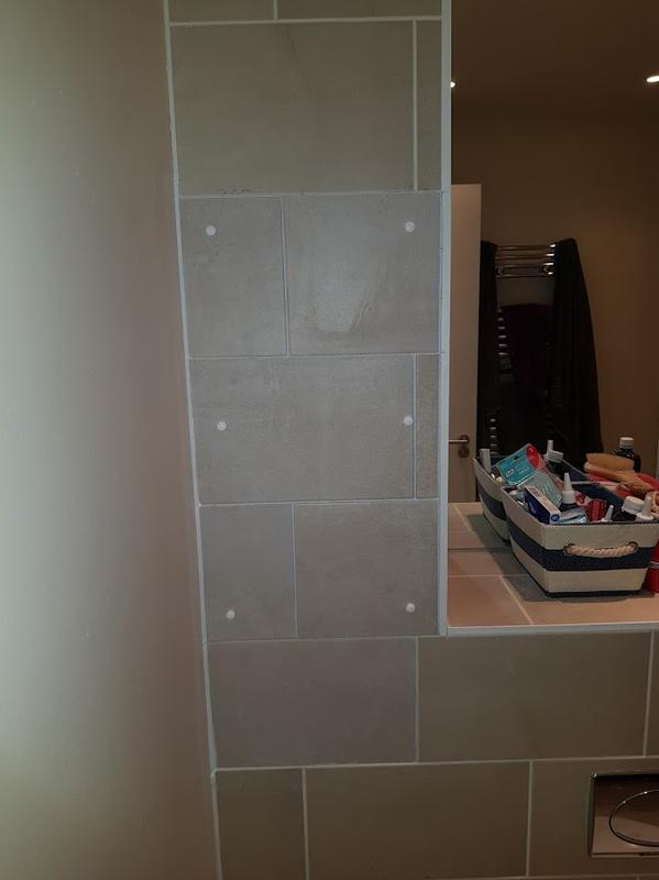 Image 19 - this is the new tiled access panel we made to repair damage