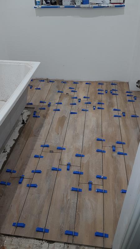 Image 18 - Bathroom floor tiled with 1200x200 wood effect tiles