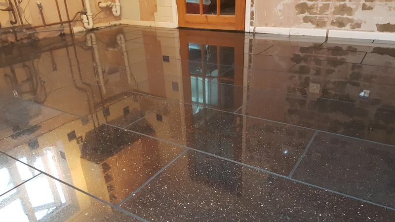Image 17 - Granite kitchen floor finished with a black grout