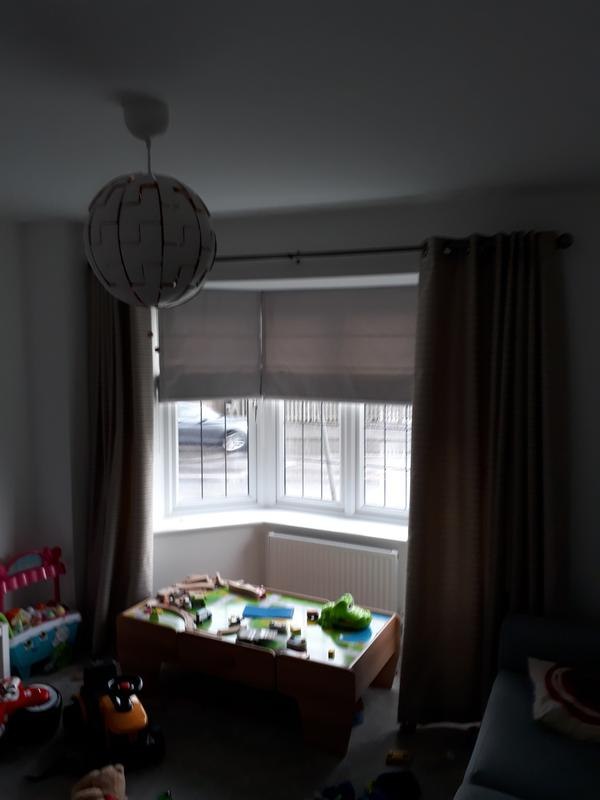 Image 9 - roman blinds on a bay window