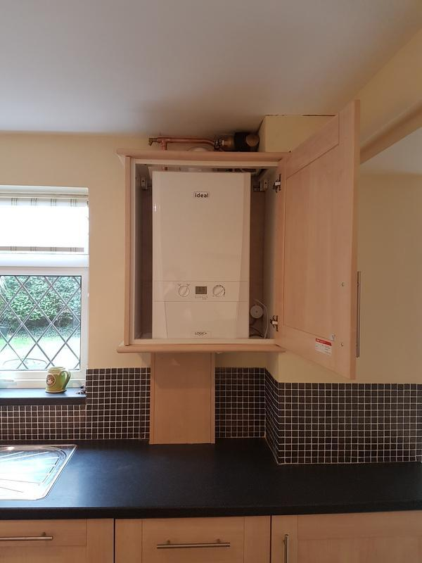 Image 6 - (After) boiler replacement with cupboard alterisation.