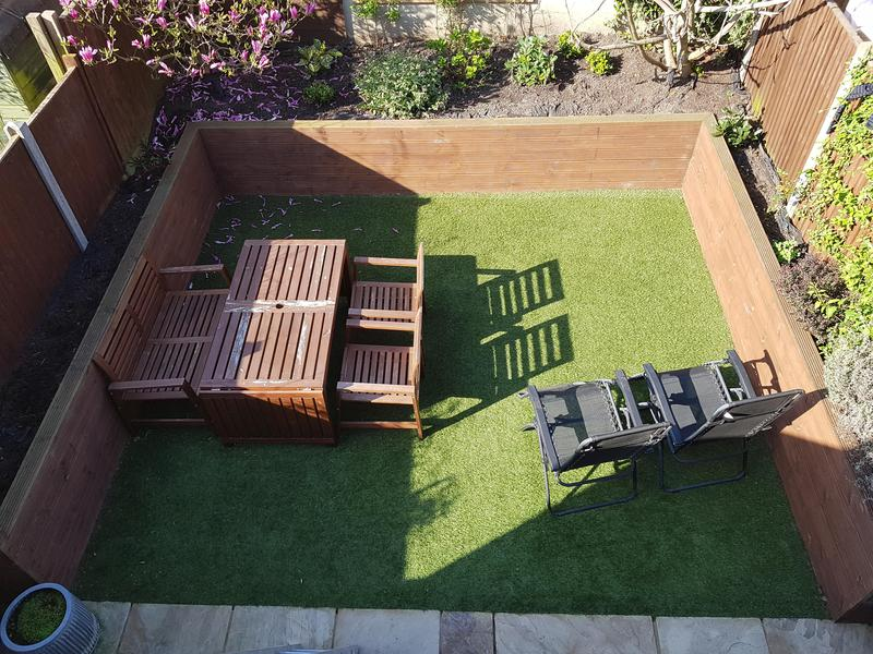 Image 4 - Artificial grass and raised decking flower bed created in this small garden
