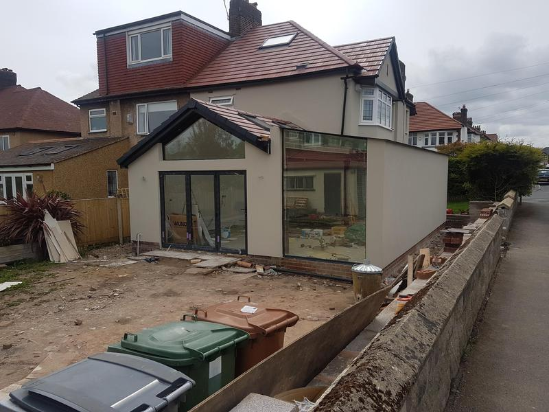 Image 6 - Rendered extension and main house in pebble coloured coating.