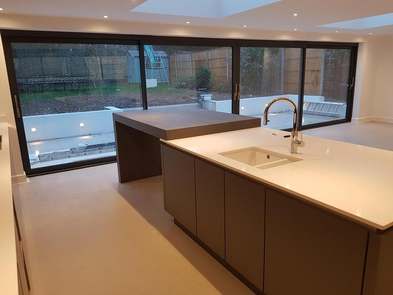 Image 17 - Stylish German kitchen installed into this ground floor extension with large roof lights and full width sliding doors