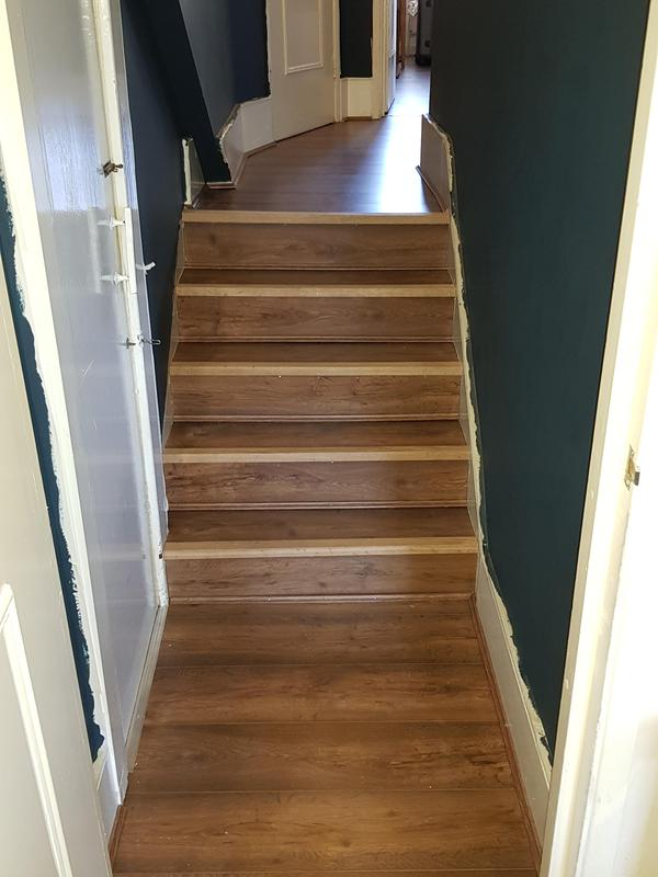 Image 43 - Laminate flooring installed on a staircase with hardwood stair nosing which was later varnished the same colour as the floor.
