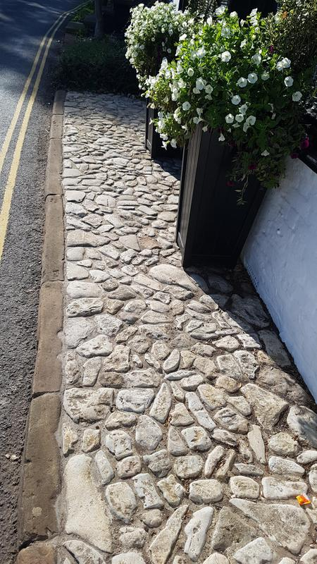 Image 23 - Reclaimed Limestone cobbles, with a reclaimed Sandstone Curb