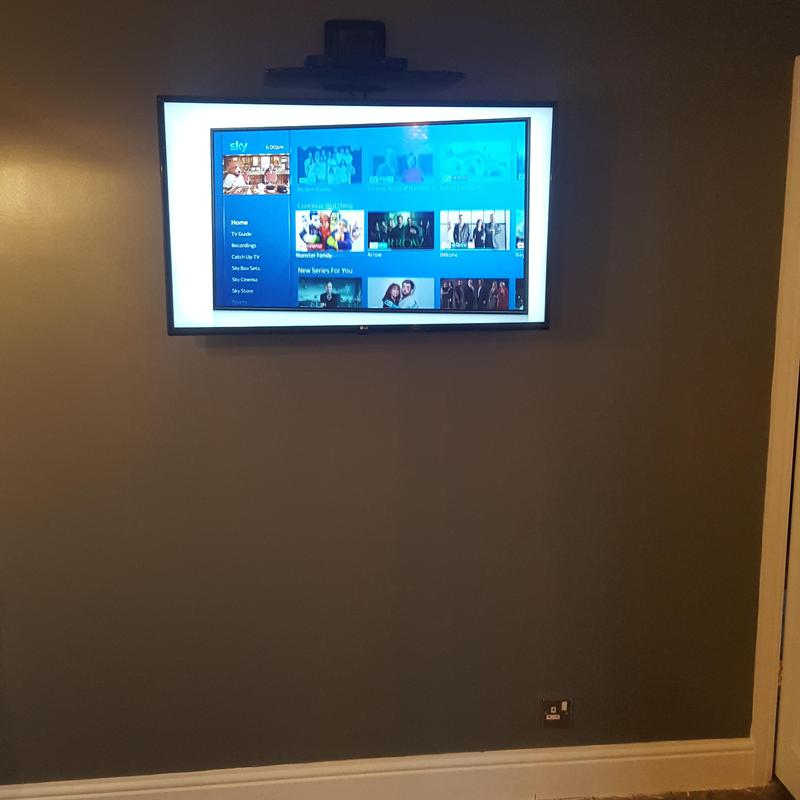 Image 5 - TV wall mounted with cables in the wall.