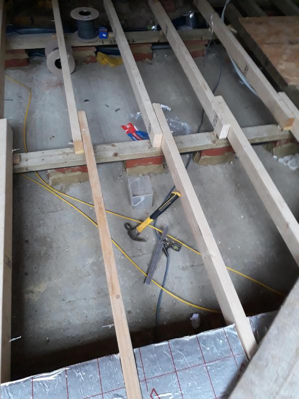 Image 29 - Installation of wood framework for floating floor.
