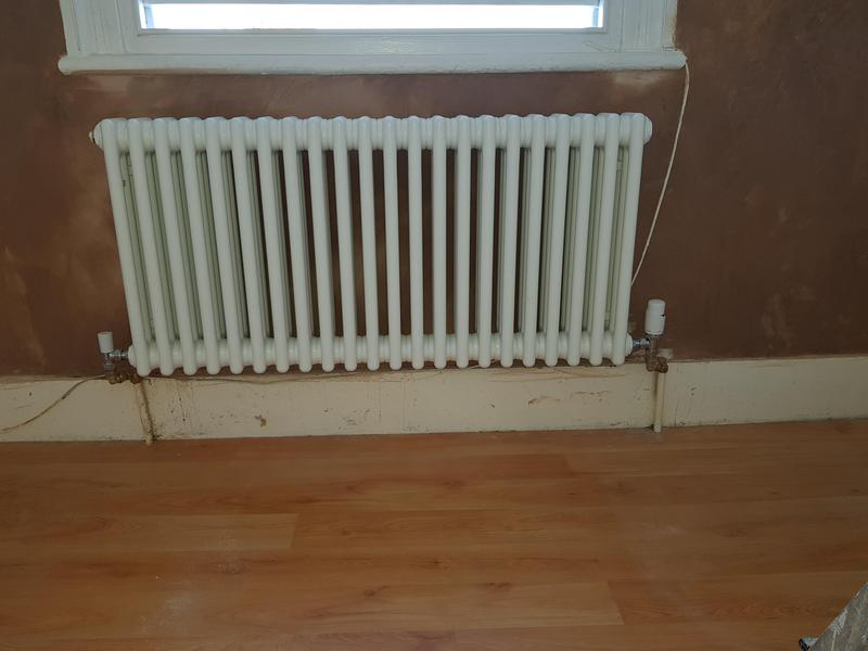 Image 13 - Wall plastered and new radiator installed.