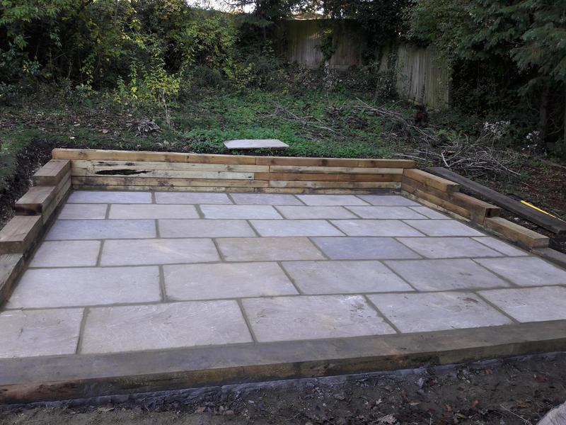 Image 7 - Sandstone paving with wooden sleeper surround - after