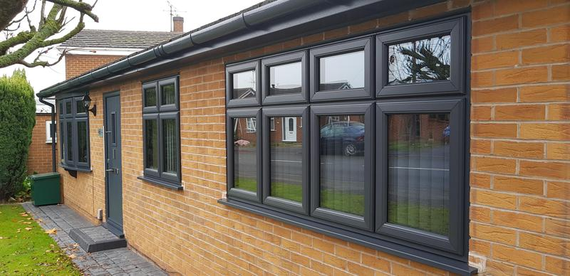 Image 2 - A recent installation in Hucknall. New grey windows and grey fascias and soffits