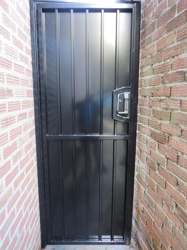 Image 285 - Bar Grill Security Steel Door with Solid Steel Sheeting, Powder Coated