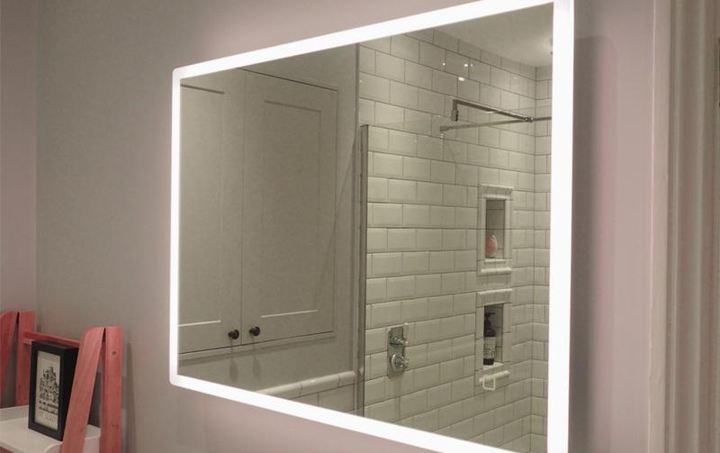 Image 25 - Traditional bathroom with a back lit LED wall mirror in St Albans.