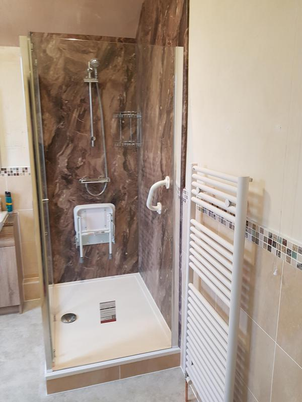 Image 12 - Finished bathroom in ilkeston. Customer wanted something easier to get into to wash. So a large shower tray complete with fold up seat and grab rails.