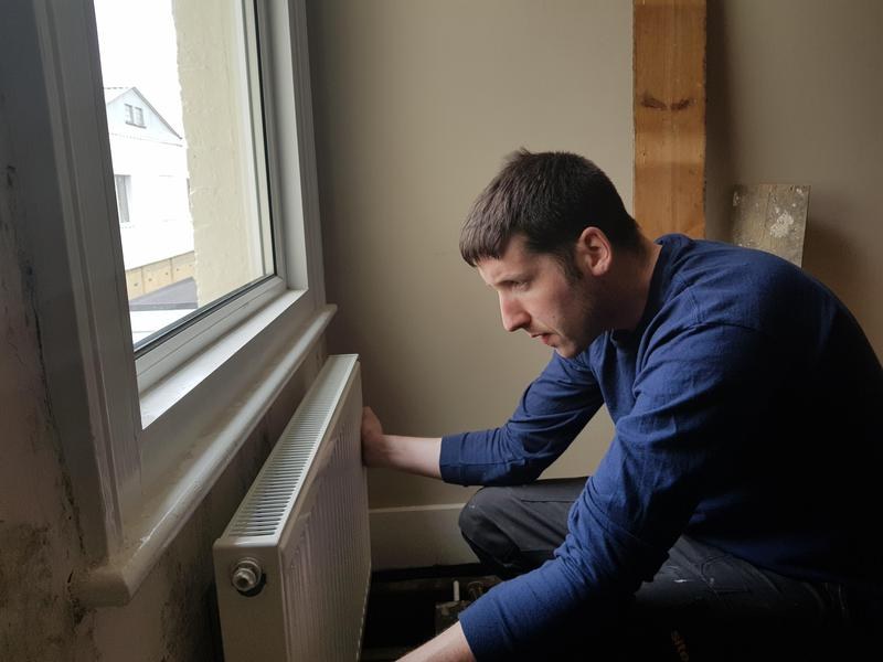 Image 6 - John hanging a new radiator
