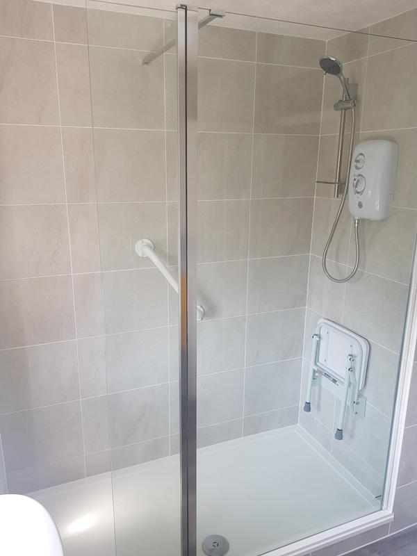 Image 2 - Shower seat and grab rails fitted to make it easier for the elderly lady to get in and showered with ease.