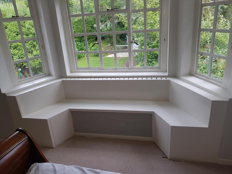 Image 1 - Bespoke window seat built from scratch and painted. This holds radiator inside and has storage on the side sections.