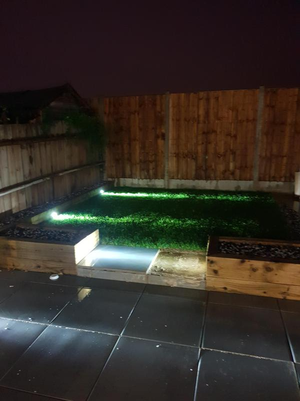 Image 11 - Garden lights mounted in the sleepers giving light across the grass and tile areas