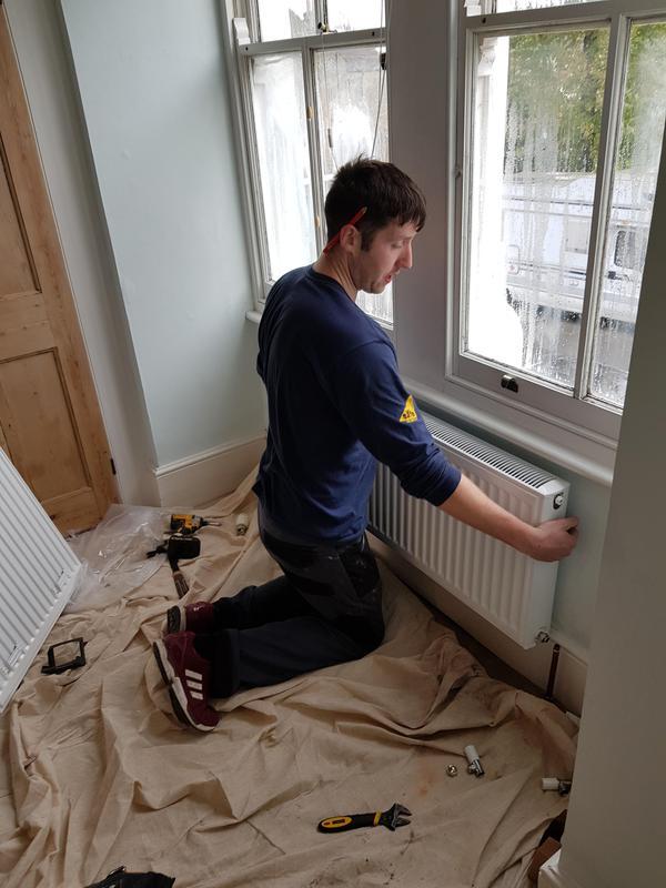 Image 11 - John hanging a radiator