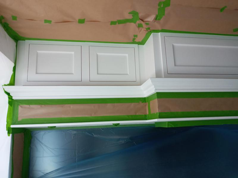 Image 5 - Kitchen cabinets before spray works.