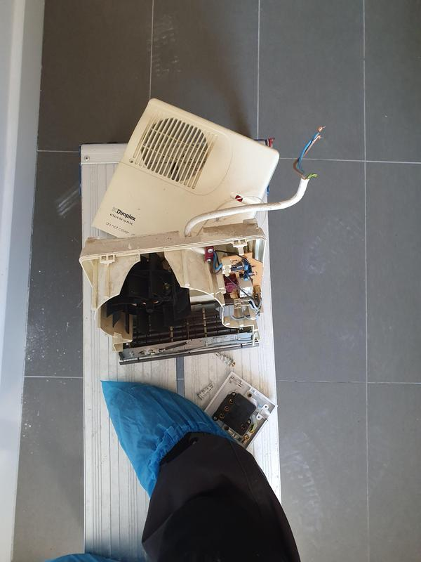 Image 52 - Removed old electric heater for client