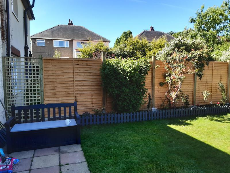 Image 2 - Trellis for climbing plants and start of fencing.