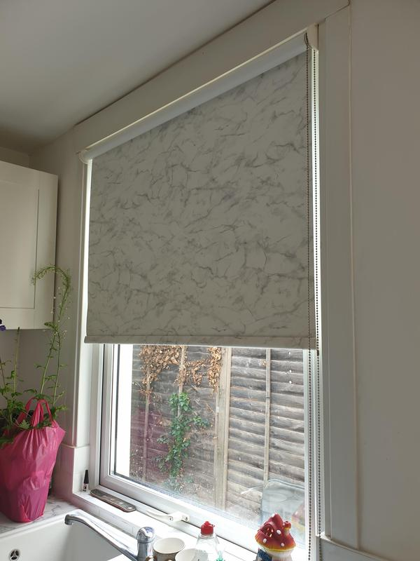 Image 23 - Marble effect roller blind fitted for a customer's kitchen in Stone.