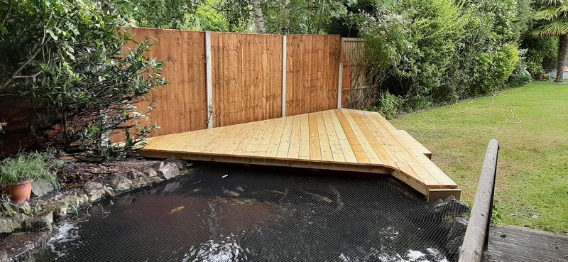 Image 3 - decking covering half over koi pond