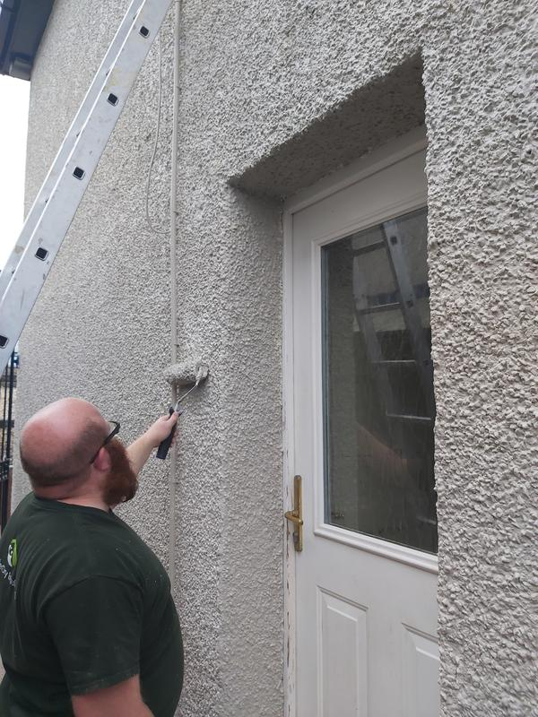 Image 1 - A colour coating being applied. This protects the property from penetrating damp as well giving it a brand new look.
