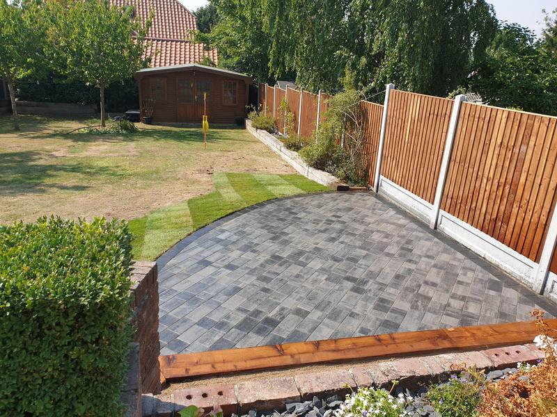 Image 27 - Installed 20m2 patio area in Barleystone Castlepave Smooth Silver Grey with a Damson Border. We also removed and replaced fencing and installed treated railway sleepers.