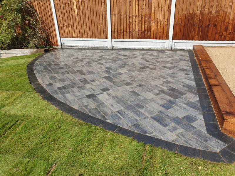 Image 26 - Installed 20m2 patio area in Barleystone Castlepave Smooth Silver Grey with a Damson Border. We also removed and replaced fencing and installed treated railway sleepers.