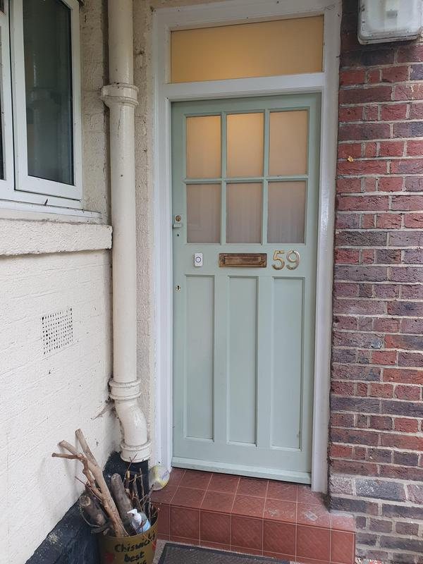Image 19 - White laminated glass retro fitted into old single glazed door.