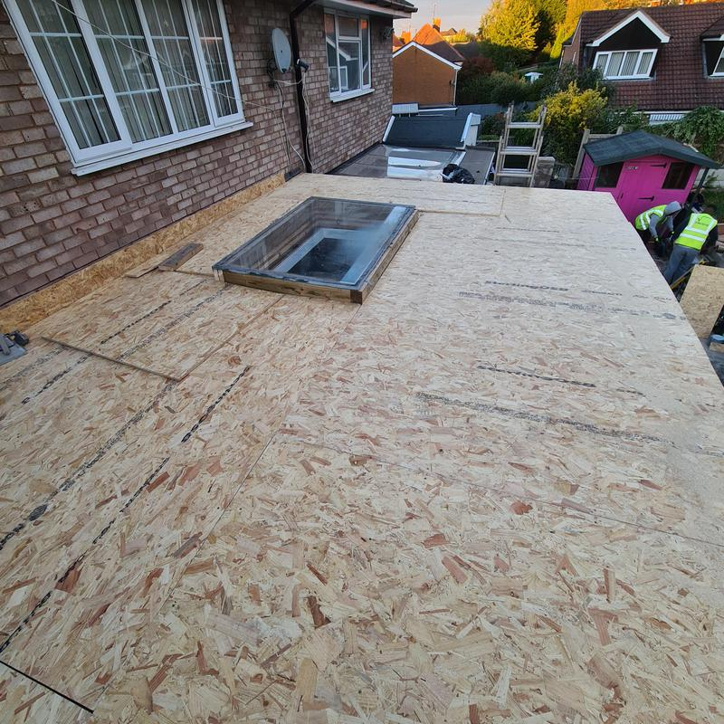 Image 34 - Installed osb boards. Refitted the skylight from scratch. The customer provided us with toughened glass. Took four of us to move it. Installed osb upstand ready for EPDM and wall cut out for drip plate to be fitted and filled with external silicone.