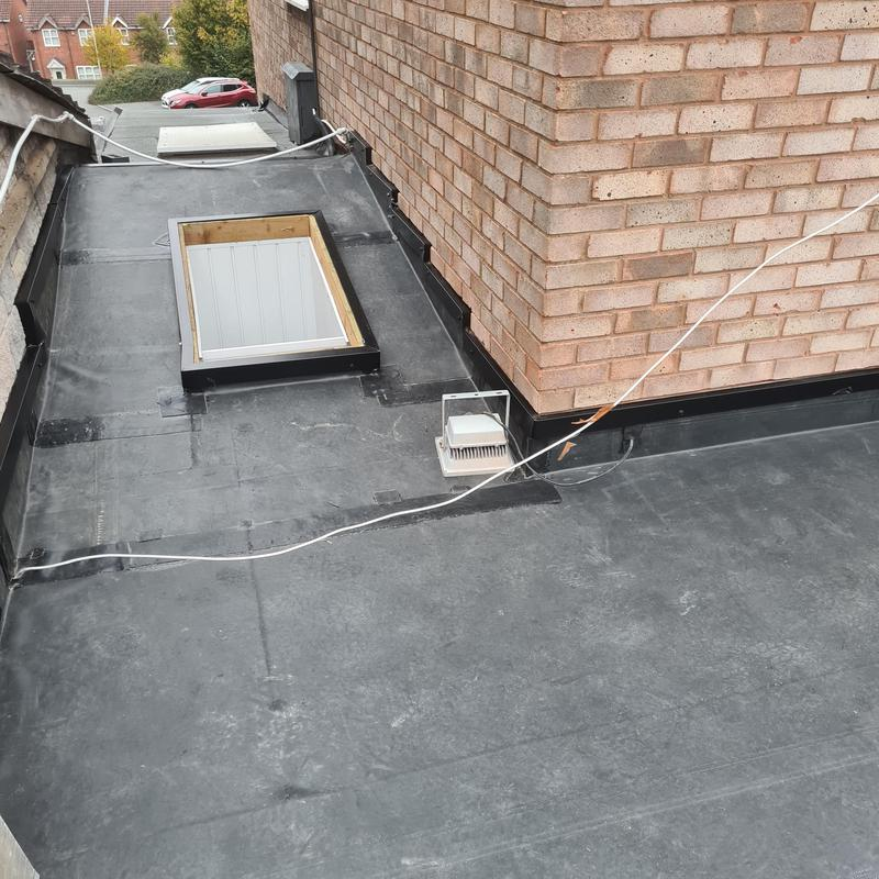 Image 33 - Finished of with black metal trims to secure EPDM to wall, this area was done with off cuts to save further costs and have less wastage.
