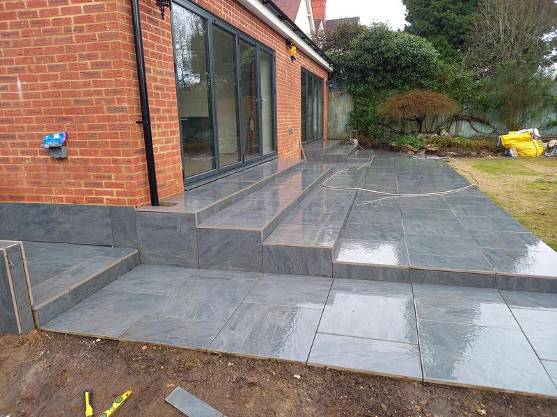 Image 5 - A complete transformation we have made here using an anthracite grey paving slab, we have build a symmetrical set of steps to the underside of each bi-folding patio door on this new extension in Reigate,Surrey. A very happy customer so far. Lots of pictures to follow.
