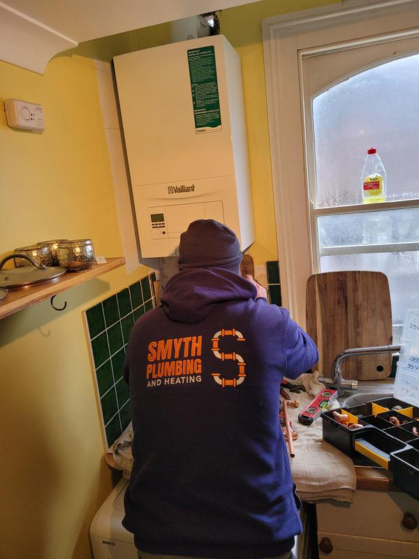 Image 2 - Simon fitting a new eco fit pure boiler.